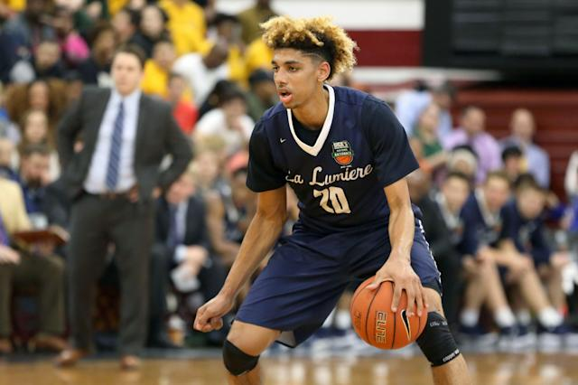 FILE - In this Friday, April 1, 2016 file photo, La Lumiere's Brian Bowen (20) moves the ball against Montverde Academy in the DICK'S Sporting Goods High School National Basketball Tournament in the Queens borough of New York. Suspended Louisville freshman Brian Bowen Jr. has signed to play with South Carolina. Bowen was held out of practices and games after Louisville announced it was being investigated as part of a federal corruption probe of bribery in college basketball that led to the firing of coach Rick Pitino. (AP Photo/Gregory Payan, File)