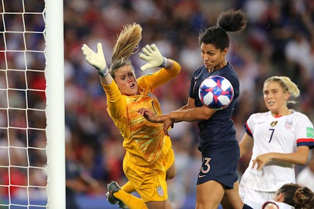 Alyssa Naeher of the USA battles for possession with Valerie Gauvin of France during the 2019 FIFA Women's World Cup France Quarter Final match between France and USA at Parc des Princes on June 28, 2019 in Paris, France. (Photo by Elsa/Getty Images)