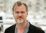 """FILE - In this May 12, 2018, file photo, director Christopher Nolan poses during a photo call at the 71st international film festival, Cannes, southern France. The only post-shutdown films to crack the top 10 in 2020 are Nolan's """"Tenet,"""" in eighth place with $57.2 million and the animated family sequel """"The Croods: A New Age,"""" which was released at Thanksgiving and has earned $30.8 million so far to put it in 10th place. (Photo by Arthur Mola/Invision/AP, File)"""
