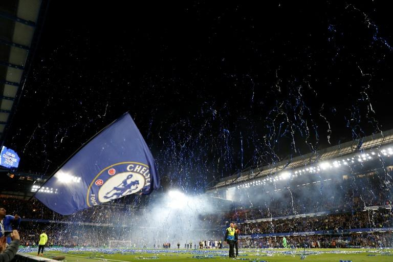 Streamers errupt over the pitch at the end of the English Premier League  match against Watford at Stamford Bridge