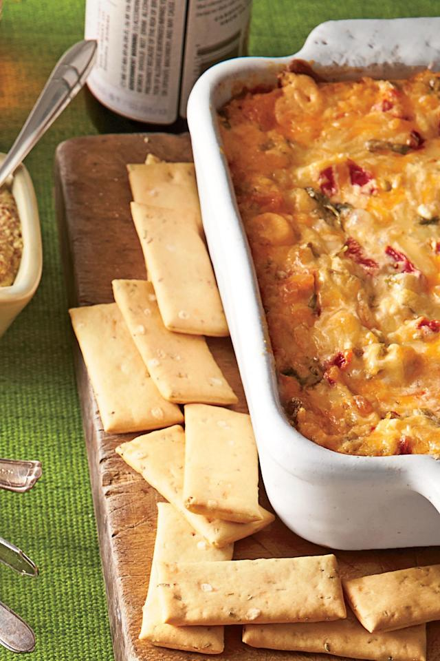 """<p><b>Recipe: <a href=""""https://www.southernliving.com/syndication/red-pepper-cheese-dip"""">Baked Tex-Mex Red Pepper Cheese Dip</a></b></p> <p>Every cookout needs an incredible dip on deck for guests that arrive hungry, and we're happy to report that this addicting recipe is ready for the job.</p>"""