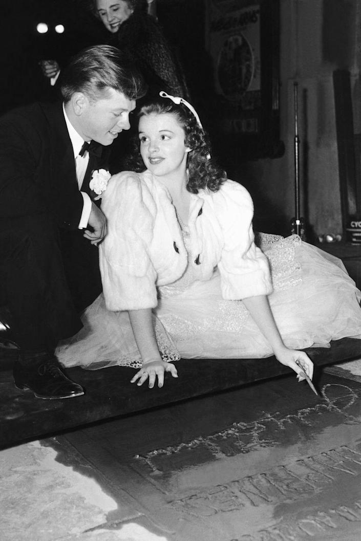 <p>Judy received the honor of leaving her hand and footprints in the cement outside the famous Grauman's Chinese Theater in Los Angeles. Mickey Rooney accompanied her. </p>
