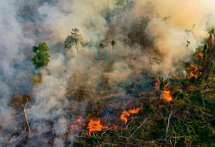 """Smoke and flames rise from an illegally lit fire in Amazon rainforest reserve, south of Novo Progresso in Para state, Brazil, on Aug. 15, 2020.<span class=""""copyright"""">Carl de Souza / AFP via Getty Images</span>"""