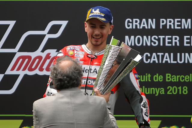 MotoGP - Grand Prix of Catalunya - Circuit de Barcelona-Catalunya, Barcelona, Spain - June 17, 2018 Ducati Team's Jorge Lorenzo is presented the trophy by Newly elected Catalan regional leader Quim Torra after winning the race REUTERS/Jon Nazca