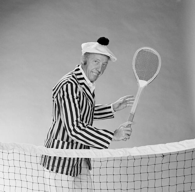 "<p>Arthur ""Bud"" Collins was an American sports journalist best known for his tennis reporting. He died on March 4 at the age of 86.; — (Pictured) Tennis commentator Bud Collins in 1977. (NBCU Photo Bank via Getty Images) </p>"