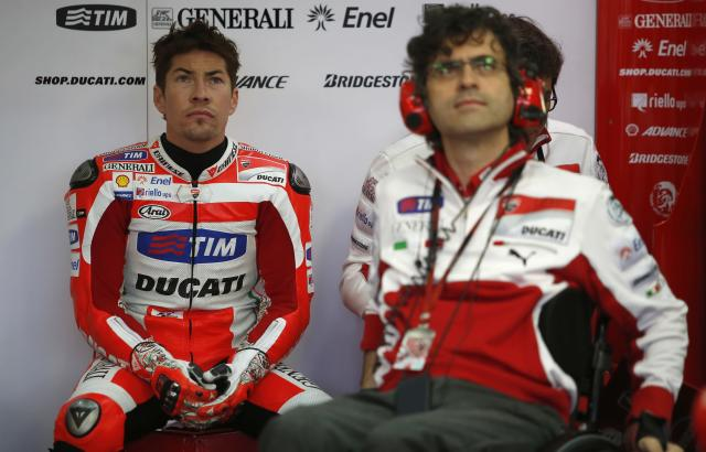 Ducati Team's US rider Nicky Hayden (L) looks on inside the pit during the Moto GP Training session of the Valencia Grand Prix at Ricardo Tormo racetrack in Cheste, on November 9, 2012. AFP PHOTO/ JOSE JORDANJOSE JORDAN/AFP/Getty Images