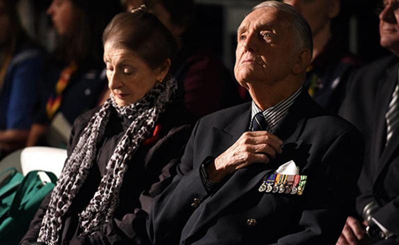 An ex-serviceman watches on during the Anzac Day dawn service in Sydney. Source: AAP.