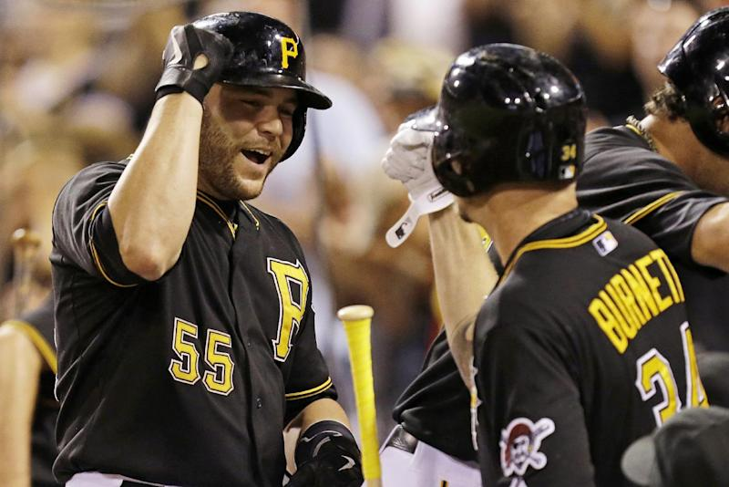 Pittsburgh Pirates' Russell Martin (55) celebrates with Pittsburgh Pirates starting pitcher A.J. Burnett (34) after hitting a three-run home run off St. Louis Cardinals starting pitcher Lance Lynn (31) during the third inning of a baseball game in Pittsburgh Saturday, Aug. 31, 2013. (AP Photo/Gene J. Puskar)