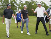 Bubba Watson, left, and Scottie Scheffler, right, talk with Patrick Cantlay, center, as they walk to the 10th hole during the second round of the Zurich Classic golf tournament at TPC Louisiana in Avondale, La., Friday, April 23, 2021. (Max Becherer/The Times-Picayune/The New Orleans Advocate via AP)