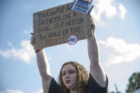<p>Sophie Phillips holds a sign as she attends a rally for those heading to the March for Our Lives event in Washington D.C., on March 20, 2018, in Parkland, Florida. (Photo by Joe Raedle/Getty Images) </p>