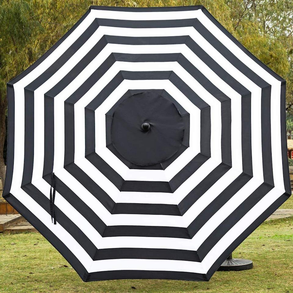"""You'll be sure to get plenty of shade from the sun when it's hot outside with this cute umbrella. It's adjustable and you can move it from side to side to help you stay cool and sunburn-free while you're eating or lounging.<br /><br /><strong>Promising review:</strong>""""I got the red umbrella for my deck. It is big, beautiful, and the perfect color for good shade on a sunny afternoon. My deck is on the west side of my home and gets direct sun.<strong>This umbrella is exactly what I needed. The dark red provides nice shade for relaxing at the table with your favorite beverage and snack.</strong>The easy put up and take down is a plus for enjoyment."""" —<a href=""""https://amzn.to/32H12YG"""" target=""""_blank"""" rel=""""nofollow noopener noreferrer"""" data-skimlinks-tracking=""""5580838"""" data-vars-affiliate=""""Amazon"""" data-vars-href=""""https://www.amazon.com/gp/customer-reviews/R1NVOSI217YVO5?tag=bfgenevieve-20&ascsubtag=5580838%2C20%2C33%2Cmobile_web%2C0%2C0%2C1159950"""" data-vars-keywords=""""cleaning,fast fashion"""" data-vars-link-id=""""1159950"""" data-vars-price="""""""" data-vars-product-id=""""16176892"""" data-vars-retailers=""""Amazon"""">Amazon Customer</a><br /><br /><strong>Get it from Amazon for<a href=""""https://amzn.to/2Qr99Wv"""" target=""""_blank"""" rel=""""nofollow noopener noreferrer"""" data-skimlinks-tracking=""""5580838"""" data-vars-affiliate=""""Amazon"""" data-vars-asin=""""B07L1Q51XC"""" data-vars-href=""""https://www.amazon.com/dp/B07L1Q51XC?tag=bfgenevieve-20&ascsubtag=5580838%2C20%2C33%2Cmobile_web%2C0%2C0%2C1159946"""" data-vars-keywords=""""cleaning,fast fashion"""" data-vars-link-id=""""1159946"""" data-vars-price="""""""" data-vars-product-id=""""7673396"""" data-vars-product-img=""""https://m.media-amazon.com/images/I/31REFWyhfuL.jpg"""" data-vars-product-title=""""Sunnyglade 9' Patio Umbrella Outdoor Table Umbrella with 8 Sturdy Ribs (Balck and White)"""" data-vars-retailers=""""Amazon"""">$48.99</a>(available in seven colors).</strong>"""