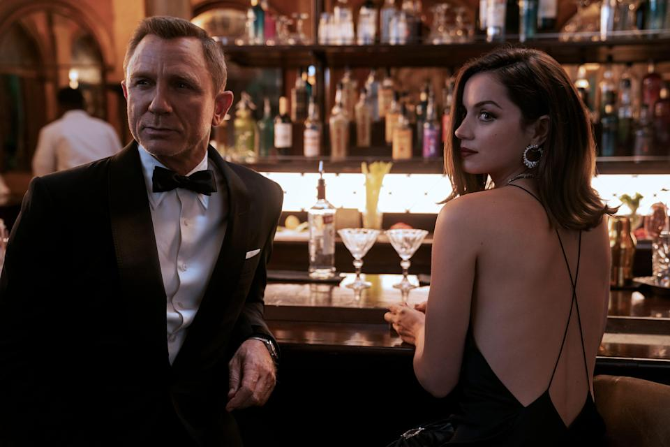 """James Bond (Daniel Craig) hits the bar with Paloma (Ana de Armas) in the latest 007 film """"No Time to Die."""""""
