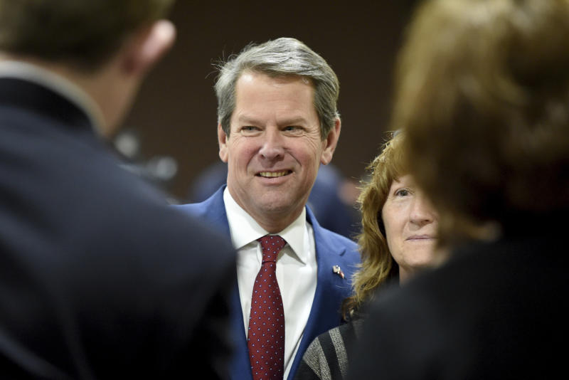 """Georgia Governor-elect Brian Kemp, middle, poses for photos with supporters during a stop in Augusta, Ga., as part of what he calls his """"thank-you tour"""" Wednesday Jan. 9, 2019. Kemp says he plans to focus his first year in office on helping small businesses, cutting taxes and cracking down on violent gangs. (Michael Holahan/The Augusta Chronicle via AP)"""