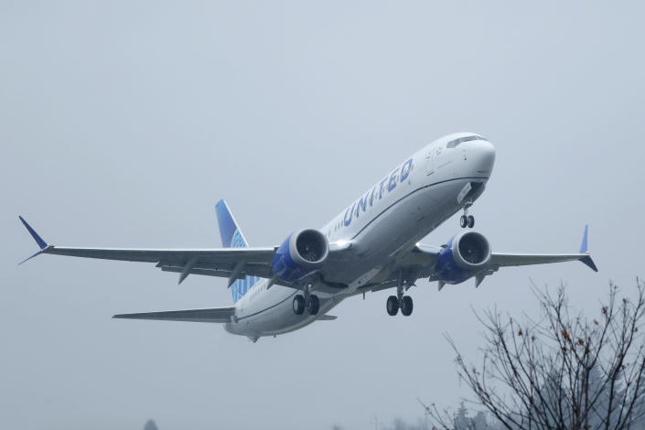 FILE - In this Dec. 11, 2019, file photo a United Airlines Boeing 737 Max airplane takes off in the rain at Renton Municipal Airport in Renton, Wash. United Airlines says the Boeing 737 Max has been pulled from its flight schedule until June, the latest in a string of troubling news plaguing the airplane manufacturer. (AP Photo/Ted S. Warren, File)