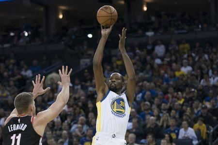 December 11, 2017; Oakland, CA, USA; Golden State Warriors forward Kevin Durant (35) shoots the basketball against Portland Trail Blazers center Meyers Leonard (11) during the second quarter at Oracle Arena. Mandatory Credit: Kyle Terada-USA TODAY Sports