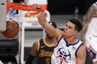 Denver Nuggets forward Michael Porter Jr. dunks during the second half of an NBA basketball game against the Los Angeles Lakers Monday, May 3, 2021, in Los Angeles. (AP Photo/Mark J. Terrill)