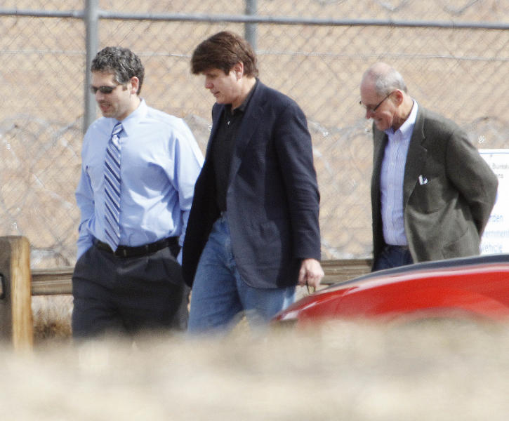 Former Illinois Gov. Rod Blagojevich, center, walks with attorneys as he arrives at the Federal Correctional Institution Englewood in Littleton, Colo., on Thursday, March 15, 2012, where he began serving his 14-year sentence for corruption. (AP Photo/Ed Andrieski)