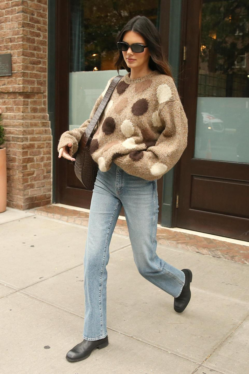 Kendall Jenner wears a sweater from Acne Studios with jeans and Chelsea boots. - Credit: Christopher Peterson / SplashNews.com