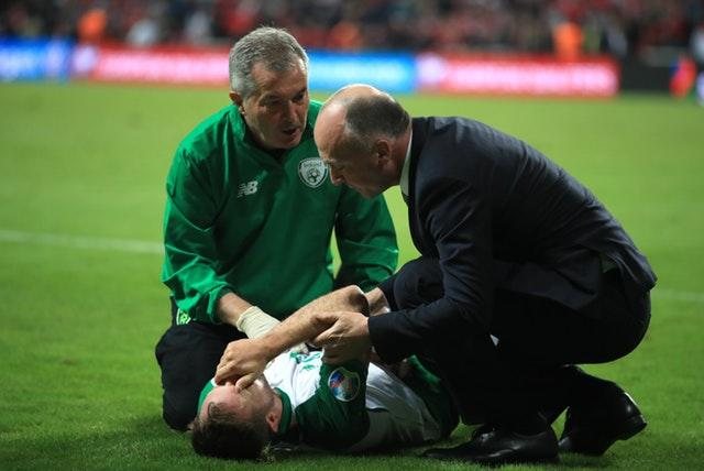 Alan Judge receives treatment on the pitch after breaking his wrist in Denmark (Bradley Collyer/PA)