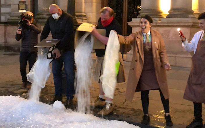 Left over ice was dumped on the street as the closures came into effect at 6pm on Friday - PA