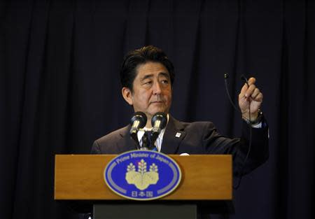Japan's Prime Minister Shinzo Abe addresses a news conference after Tokyo was selected as the city to host the 2020 Summer Olympic Games in Buenos Aires September 7, 2013. REUTERS/Martin Acosta