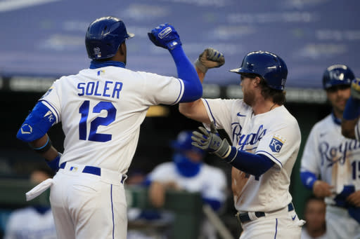 Kansas City Royals' Jorge Soler (12) is congratulated by teammate Brett Phillips, right, after hitting a three-run home run in the fourth inning of a baseball game against the Minnesota Twins at Kauffman Stadium in Kansas City, Mo., Saturday, Aug. 8, 2020. (AP Photo/Orlin Wagner)