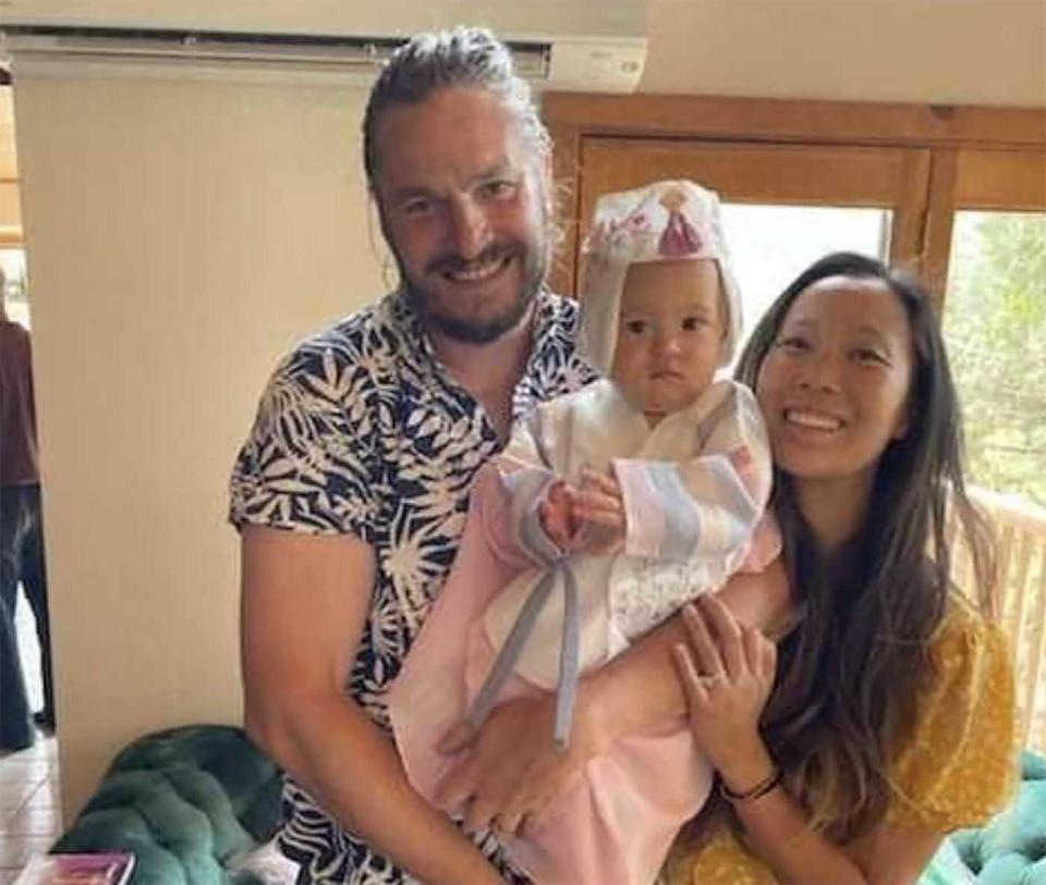 John Gerrish is pictured with his partner Ellen Chung and their one year old daughter Miju.