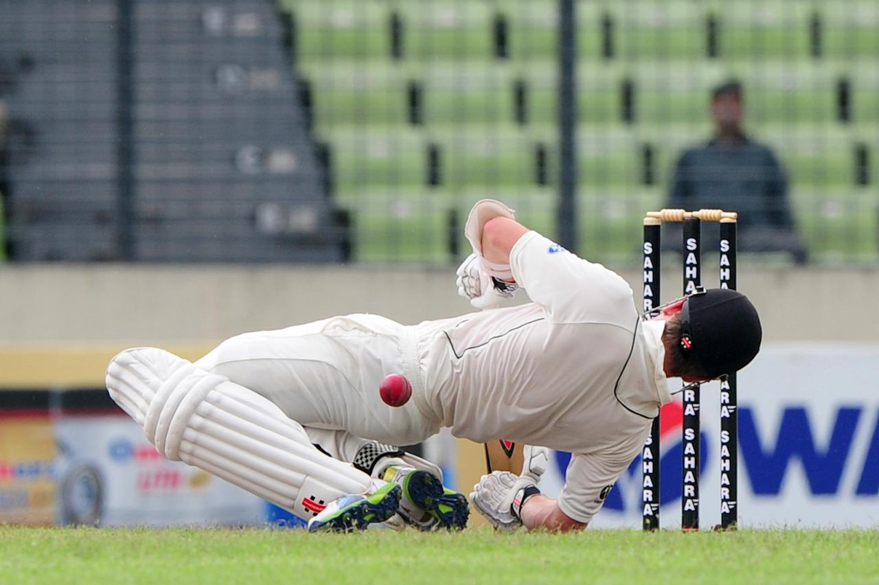 New Zealand batsman Kane Williamson is hit by a bouncer off the bowling of Bangladesh cricketer Rubel Hossain during the second day of the second cricket Test match between Bangladesh and New Zealand at the Sher-e Bangla National Stadium in Dhaka on October 22, 2013.  AFP PHOTO/ Munir uz ZAMAN        (Photo credit should read MUNIR UZ ZAMAN/AFP/Getty Images)