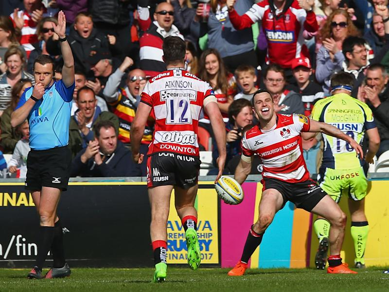 Tom Marshall celebrates scoring his second try for Gloucester: Getty