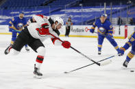 New Jersey Devils forward Pavel Zacha (37) takes a shot during the first period of an NHL hockey game against the Buffalo Sabres, Saturday, Jan. 30, 2021, in Buffalo, N.Y. (AP Photo/Jeffrey T. Barnes)