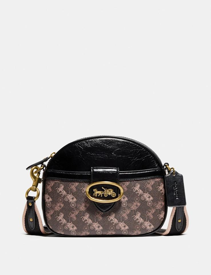 "<p>The strap on this <a href=""https://www.popsugar.com/buy/Coach-Kat-Saddle-Bag-540017?p_name=Coach%20Kat%20Saddle%20Bag&retailer=coach.com&pid=540017&price=350&evar1=fab%3Aus&evar9=45929069&evar98=https%3A%2F%2Fwww.popsugar.com%2Fphoto-gallery%2F45929069%2Fimage%2F46976882%2FCoach-Kat-Saddle-Bag&list1=shopping%2Ccoach%2Caccessories%2Cbags%2Cshoppping&prop13=api&pdata=1"" rel=""nofollow"" data-shoppable-link=""1"" target=""_blank"" class=""ga-track"" data-ga-category=""Related"" data-ga-label=""https://www.coach.com/coach-kat-crossbody-with-horse-and-carriage-print/88544.html?cgid=women-handbags-crossbody-bags&amp;dwvar_color=B4AA8#cgid=women-handbags-crossbody-bags&amp;start=16"" data-ga-action=""In-Line Links"">Coach Kat Saddle Bag</a> ($350) is so cute.</p>"