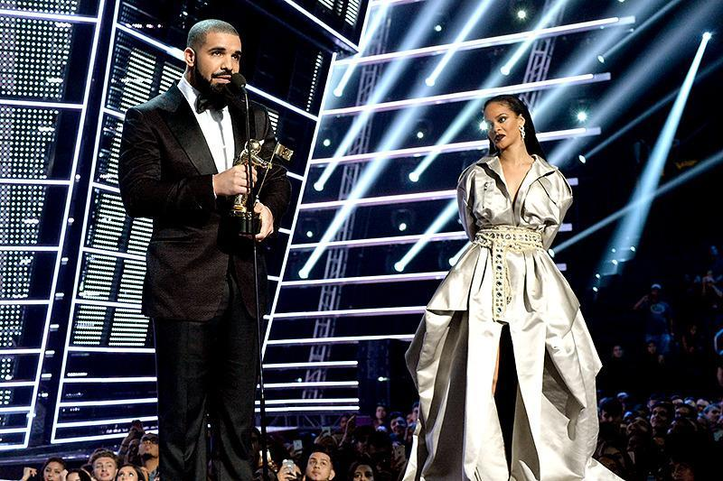 "<p>The rapper introduced his lady love on stage at the 2016 VMAs and didn't hold back his feelings. ""She's someone I've been in love with since I was 22 years old,"" he <a href=""https://www.yahoo.com/celebrity/drake-sooo-feelings-over-rihanna-000000180.html"" data-ylk=""slk:gushed.;outcm:mb_qualified_link;_E:mb_qualified_link;ct:story;"" class=""link rapid-noclick-resp yahoo-link"">gushed.</a> ""She's one of my best friends in the world. All my adult life, I've looked up to her even though she's younger than me. She's a living breathing legend in our industry."" Rihanna sneakily let him give her a kiss before she accepted the award (even though we all thought he got burned at first). (Photo: FilmMagic) </p>"