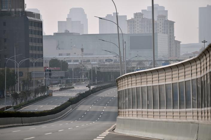A major road going through the streets of the city remains deserted as people stay at home and avoid transport due to the virus outbreak in the city of Wuhan in Hubei province on January 29, 2020.