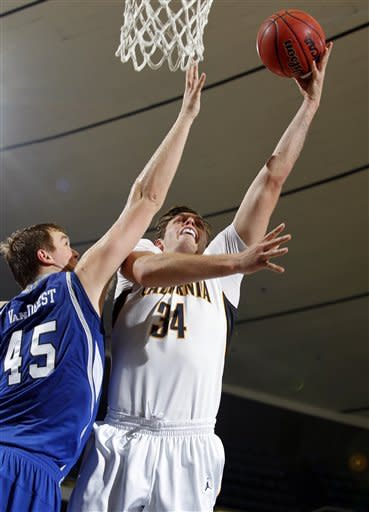 California forward Robert Thurman (34) shoots over Drake center Seth VanDeest (45) during the first half of their NCAA college basketball game in the first round of the DirecTV Classic in Anaheim, Calif., Thursday, Nov. 22, 2012. (AP Photo/Alex Gallardo)