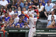 Cincinnati Reds' Joey Votto gestures while returning to the dugout after hitting a home run against the Chicago Cubs during the third inning of a baseball game Tuesday, July 27, 2021, in Chicago. (AP Photo/David Banks)