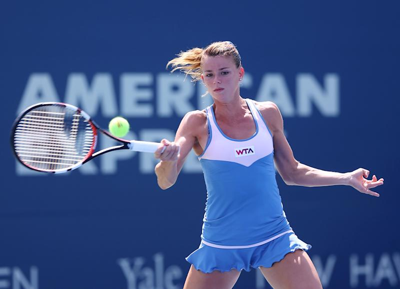 Italy's Camila Giorgi during her Connecticut Open match against Caroline Wozniacki in New Haven, Connecticut on August 20, 2014