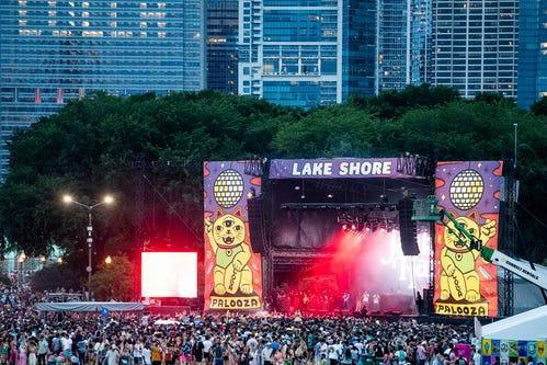 People attend the second day of the Lollapalooza Music Festival, Friday, July 30, 2021, at Grant Park in Chicago.