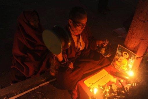 A Buddhist monk prays at the Mahabodhi temple during the sixth day of the Kalachakra Festival in Bodhgaya today
