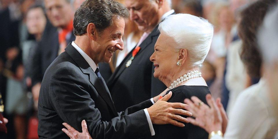 <p>With former French President Nicolas Sarkozy after receiving the chevalier of the Legion of Honour.</p>