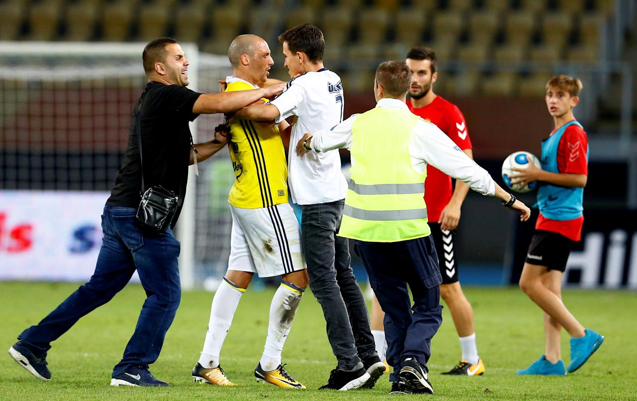 Soccer Football - Europa League - Playoffs – FK Vardar v Fenerbahce - Skopje, Macedonia - August 17, 2017   Fan runs onto the pitch and hugs Fenerbahce's Aatif Chahechouhe    REUTERS/Ognen Teofilovski     TPX IMAGES OF THE DAY