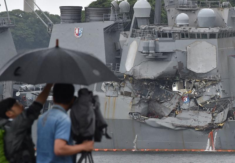 The guided missile destroyer USS Fitzgerald was badly damaged in the collision with a container ship off the coast of Japan. Investigators are trying to determine the cause of the accident which killed seven US sailors