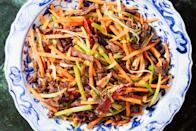 "This salty, fiery, peppery stir-fry features strips of beef and lots of julienned celery and carrots. <a href=""https://www.epicurious.com/recipes/food/views/spicy-dry-fried-beef?mbid=synd_yahoo_rss"" rel=""nofollow noopener"" target=""_blank"" data-ylk=""slk:See recipe."" class=""link rapid-noclick-resp"">See recipe.</a>"
