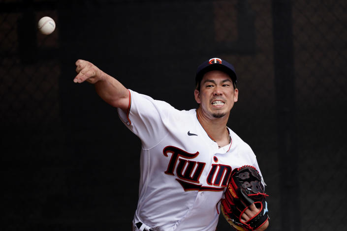 Minnesota Twins starting pitcher Kenta Maeda (18) warms up in the bullpen before a spring training baseball game against the Boston Red Sox Sunday, March 14, 2021, in Fort Myers, Fla.. (AP Photo/John Bazemore)