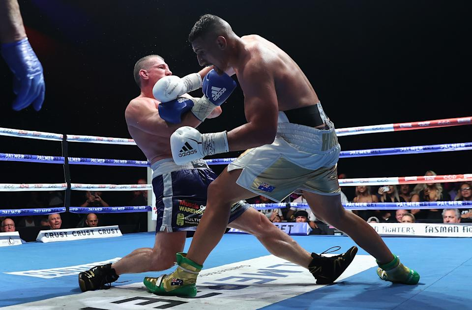 Justis Huni knocks Paul Gallen to the canvas during their Australian heavyweight title fight at ICC Sydney on June 16, 2021 in Sydney, Australia.
