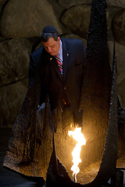 New Jersey Gov. Chris Christie rekindles the Eternal flame at the Hall of Remembrance at the Yad Vashem Holocaust memorial, in Jerusalem, Tuesday, April 3, 2012.Christie kicked off his first official overseas trip Monday meeting Israel's leader in a visit that may boost the rising Republican star's foreign policy credentials ahead of November's presidential election. (AP Photo/Bernat Armangue)