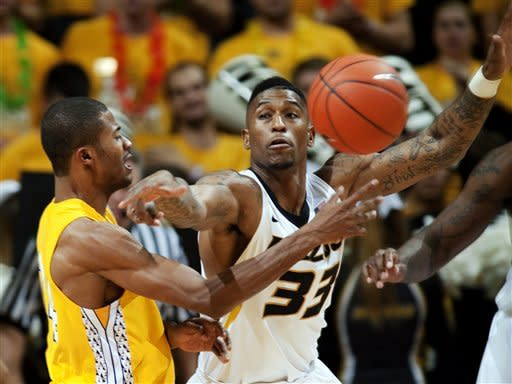 Alcorn State's Anthony Nieves, left, passes the ball around Missouri's Earnest Ross, right, during the first half of an NCAA college basketball game, Tuesday, Nov. 13, 2012, in Columbia, Mo. (AP Photo/L.G. Patterson)