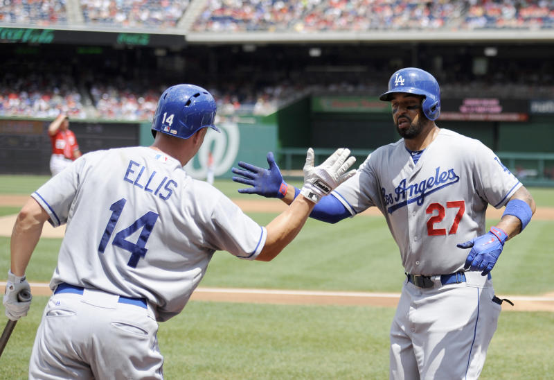 Los Angeles Dodgers' Matt Kemp (27) celebrates his home run with teammate Mark Ellis (14) during the second inning of a baseball game against the Washington Nationals, Sunday, July 21, 2013, in Washington. (AP Photo/Nick Wass)