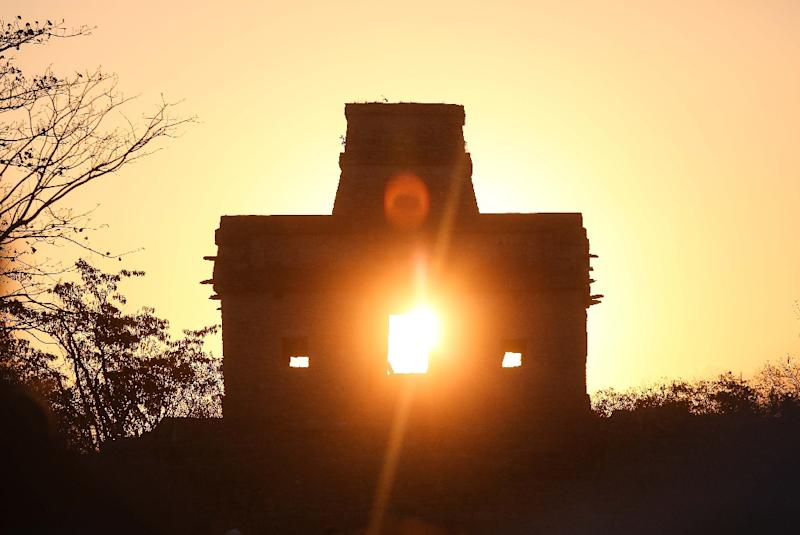 Rays of the sun pass through the Temple of the Seven Dolls in Yucatan, Mexico (AFP Photo/HUGO BORGES)