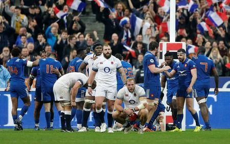 Rugby Union - Six Nations Championship - France vs England - Stade de France, Saint-Denis, France - March 10, 2018 England players look dejected as France players celebrate at the end of the match REUTERS/Regis Duvignau