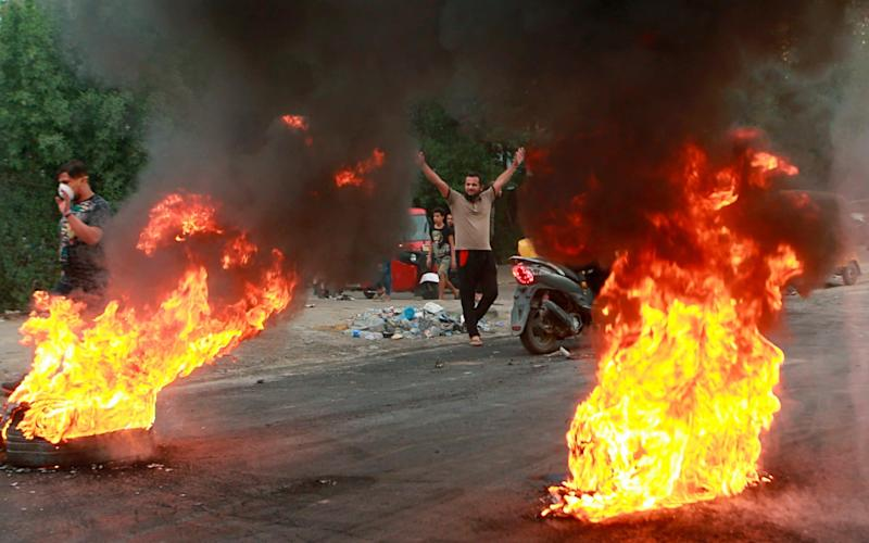 The latest clashes took place around Sadr City, a Shia district in the south of Baghdad - AP